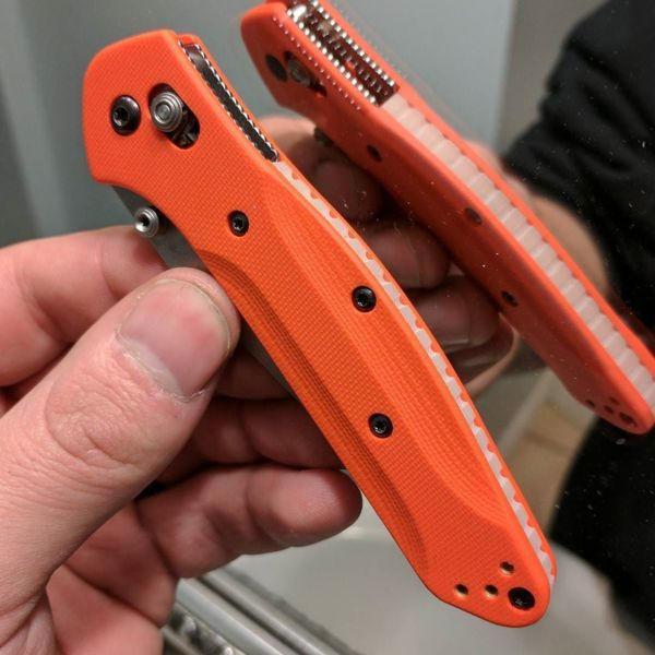 Benchmade - Orange g10 with blue moonglow, swipe to see the glow picture. #Benchmade #DeathGripScales #940 #943 #osborne #griptilian #customscales #customknives #edc...